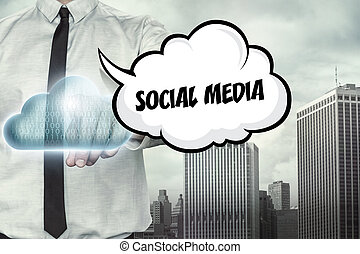 Social media text on cloud computing theme with businessman...