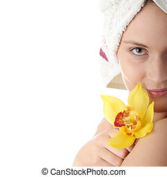 Beautiful young woman with yellow orchid