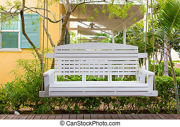 Front porch with a porch swing - Front porch with a white...
