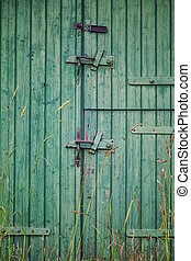 Green barn door - Image of a worn old barn door