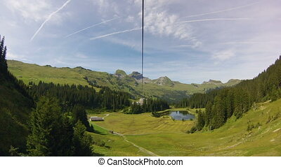 Ziplining in Switzerland - Horizontally flipped video of man...