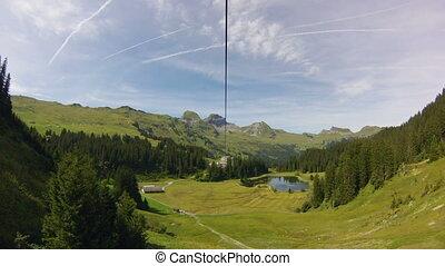 Ziplining in Switzerland - Horizontally flipped video of man...