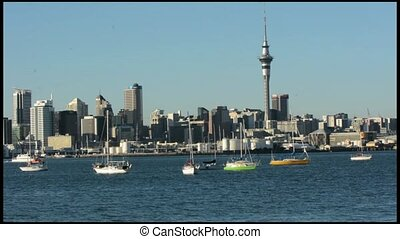 Auckland skyline with a fast ferry - Auckland downtown...