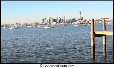 Auckland skyline with a ferry sail - Auckland downtown...