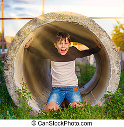 boy shouts in a tube - Teen boy shouts in a tube...