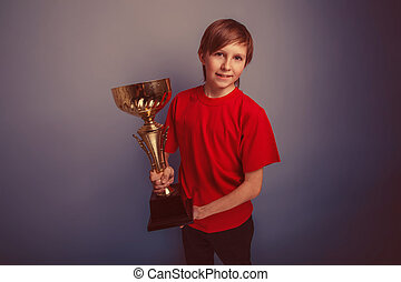 teenager boy twelve years old European appearance holds cup...