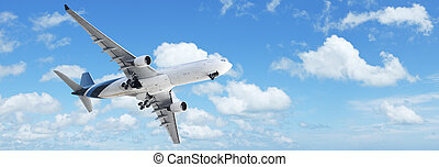 Jet in a blue cloudy sky. Panoramic composition.
