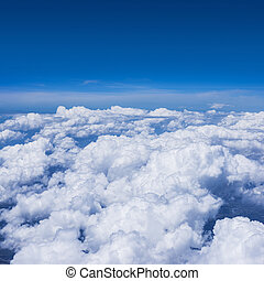 Cloudy sky from a window of jet aircraft