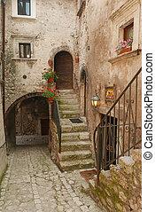 beautiful old narrow passage in italian village