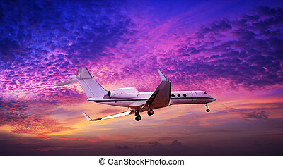 Private jet maneuvering in a spectacular sunset sky