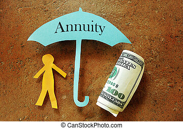 Annuity umbrella over a paper cutout person and hundred...