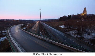 Busy expressway day becomes night - A Timelapse of a busy...
