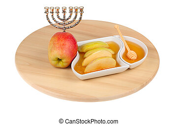 apples and dipping slices of apple in honey for Rosh...