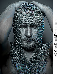 Performance, medieval executioner mesh iron rings on the head