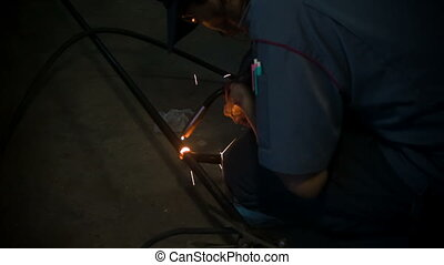 Welding man, welds tube - Welding man, welds steel tube