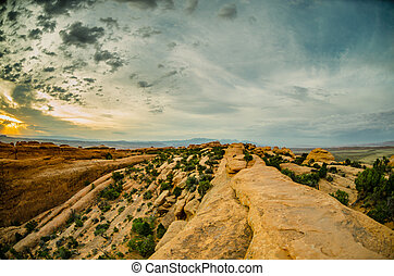 Slick Rock Hiking in Devils Garden in Morning Light - A...