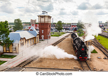 old black steam locomotive in Russia at the summer at the...