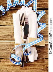 Decorative Oktoberfest table setting in a tavern or...
