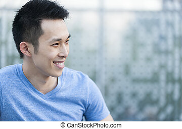 Young asian man smiling - Portrait of confident young asian...