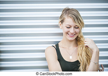 Smiling young blond woman - Candid portrait of young blonde...