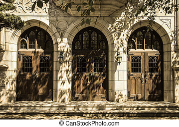 Three classic wooden church door in Sepia style