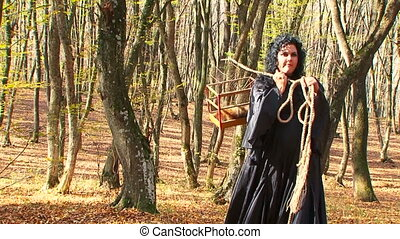 Woman In Black Walking In Autumn Forest With Cage - Two...