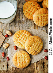 peanut butter cookies on a dark wood background. the toning....