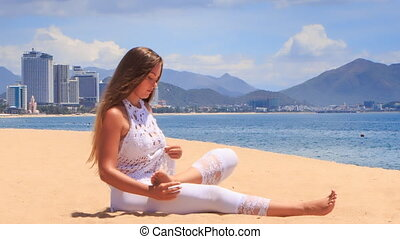girl in white lace costume demonstrates yoga asana child's...