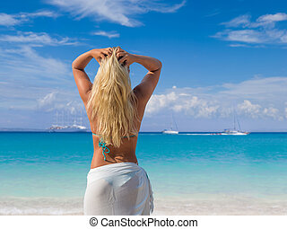 woman in white sarong on the beach. - Beautiful young woman...