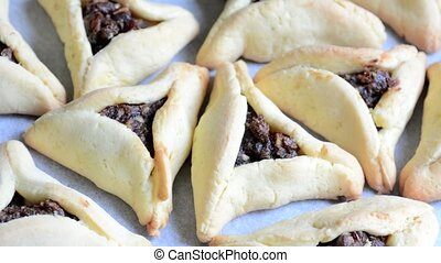 Backed Hamentashen, Ozen Haman, Purim cookies for the Jewish...