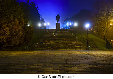 Lenin in fog - Nighttime image of Lenin monument in...