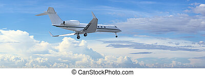 Private jet is maneuvering for landing in a cloudy sky...