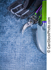 Composition of metal trowel secateurs fabric protective gloves a