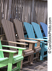 Row of Adirondack Chairs - A row of colorful Adirondack...