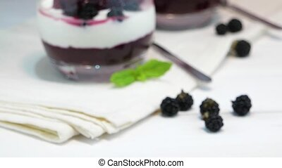 Yogurt desert with raspberries, blackberry and mint