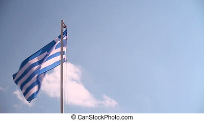 Hoisting a Greece flag with blue sky