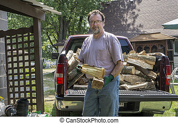 Delivering Firewood To A Customer - Delivering and stacking...