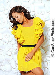 refined - Gorgeous fashion model in bright yellow dress over...
