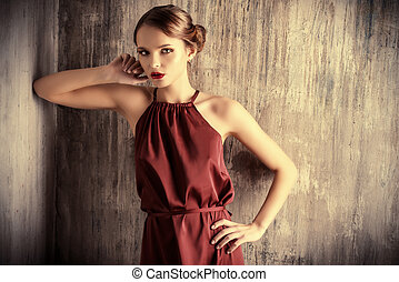 vinous dress - Sensual young lady in red dress posing an...