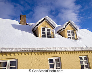 Roof covered with winter snow - Roof of a country house...