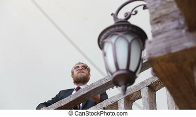 bearded man plays guitar focus moves from street light