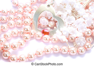 Necklace with pink stone on it,pearls and fabric flowers on...