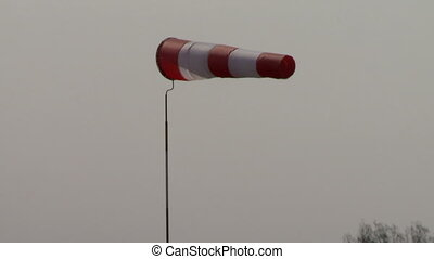 Windsock on background of somber sky - View of windsock on...