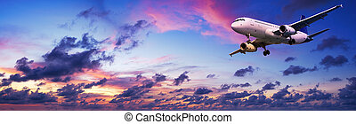 Jet aircraft in a spectacular sunset sky - Jet aircraft is...