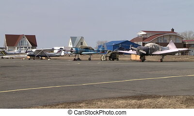 Aerodrome. Planes in covers and modern buildings