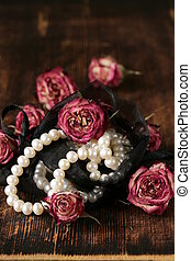 Vintage pearl with dry pink roses