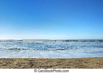 Ocean Beach in San Francisco California with waves coming to...