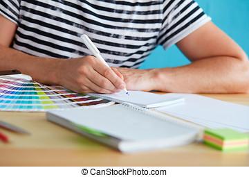 Graphic designer sketching design
