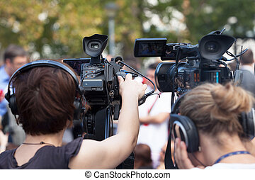 News conference. Filming an event with a video camera. -...
