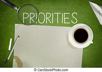 Priorities concept on black blackboard - Priorities concept...